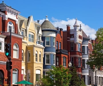 A row of colorful townhouses
