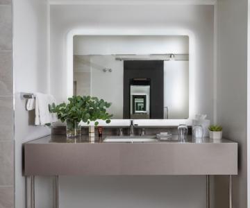 A bathroom countertop and mirror